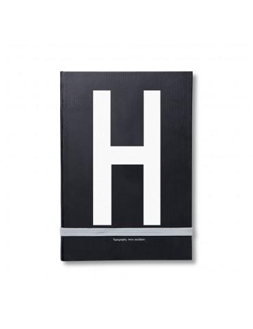 Notatnik z literą Design Letters.